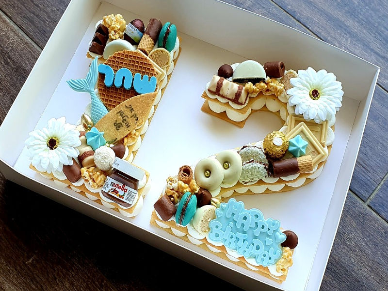עוגת מספרים ושוקולדים 12 בעיצוב גלישה